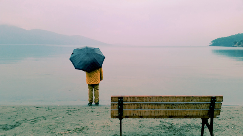 canva-person-standing-near-body-of-water-and-bench-MADGx4M1SQw